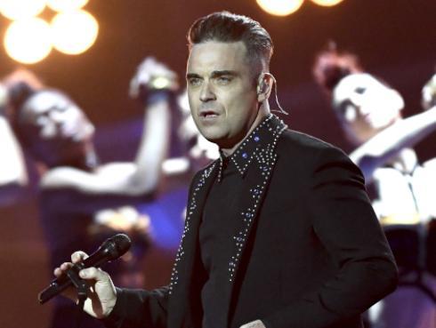 El tatuaje que Louis Tomlinson le hizo a Robbie Williams
