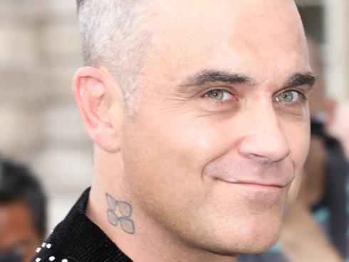 Robbie Williams invitado a una Boda Real y su hija formó parte del cortejo