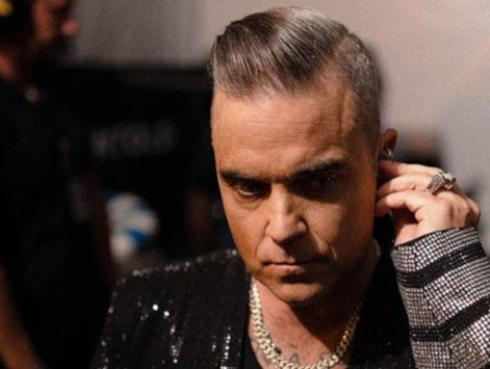 "Futbolista del Real Madrid se disculpa con Robbie Williams por no ""fichar"" por el Manchester United"
