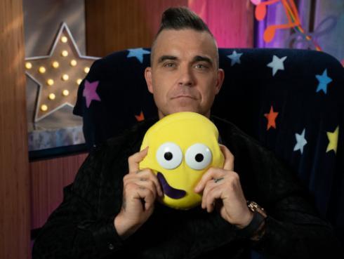 Robbie Williams bromea con la posibilidad de contratar un detective para encontrar a su excompañero