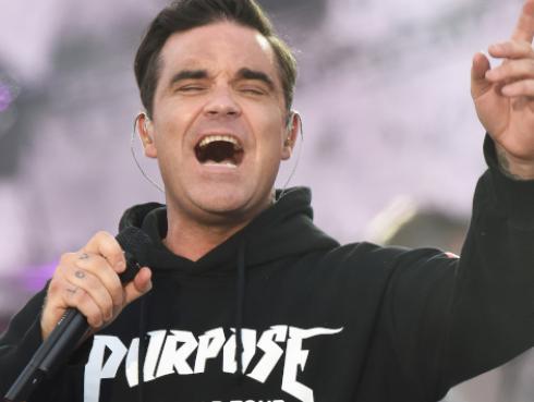 Robbie Williams encabezará el festival más importante en el Reino Unido [VIDEO]